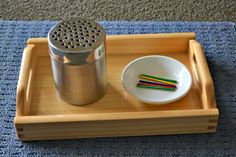 Match sticks and shaker, or drill holes in the tops of other containers - gerber snack containers? use Popsicle sticks?