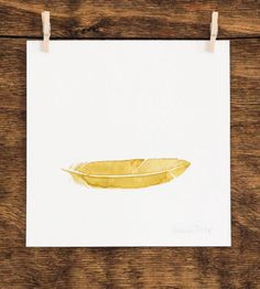 Yellow Feather - Watercolor Painting by Anna Tovar on Scoutmob Shoppe. A delicate golden feather.