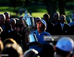 Jason Dufner of the United States poses with the Wanamaker Trophy after his two-stroke victory at the 95th PGA Championship at Oak Hill Country Club on August 11, 2013 in Rochester, New York.