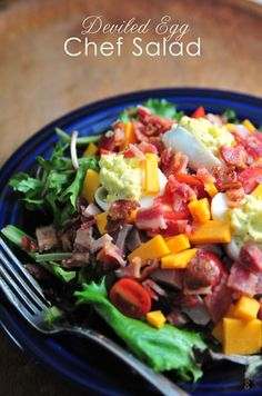 Chef Salads come in all sizes and varieties, but there are always a few things they have in common - crisp greens, two types of meat - either ham, bacon, chicken, turkey, or another favorite, hard boiled eggs, vegetables, and cheese. And since this is a version of a chef salad that I love to make