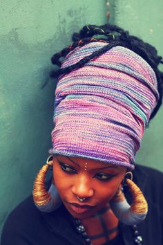 """Wall Flower"" - Manaka Handmade dreadwrap in shades of purple, pink and lilac;The wrap is stretchy so you just put it over your dreads, no tying involved. It is 30inches in length so it will fit most! You can fold it and crease it to fit all you hair in! You can also wear it if you have short dreads Just fold it over a couple more times. The wrap can be used to keep hair out of your face in summer, or to keep warm in winter or as a daily accessory"