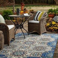 Add an outdoor rug for a boost of flair.