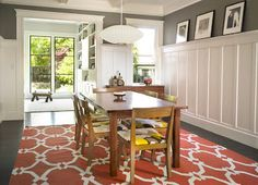 dining room wainscoting. in this dining room, the designer added a