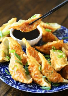 Easy Asian Dumplings with Soy-Ginger Dipping Sauce - Crispy, tender steamed potstickers, made easily in one skillet! thecomfortofcooking.com
