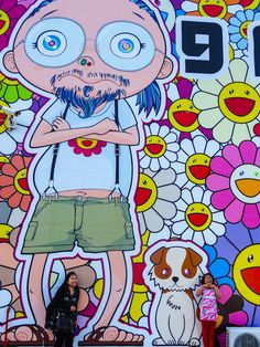 """The facade of AlRiwaq was covered with flowers and Takashi Murakami's """"portraits"""""""