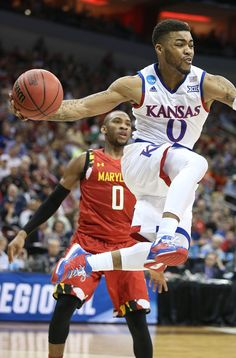 Kansas Jayhawk guard Frank Mason airborne to throw a pass during the #1 Kansas 79-63 win over #5 Maryland 3/24/16 in the Sweet Sixteen round of the NCAA tournament