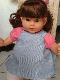 Melle L. a eu (entre autre...) pour Noelune poupée Corolle de 36cms (Modèle chouquette brune). La petite maman est équipée...