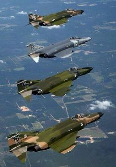 What Couldn't the Phantom Do?In four Phantoms painted in Vietnam-era markings fly a U. Air Force Heritage demonstration over Florida. Military Jets, Military Aircraft, Air Fighter, Fighter Jets, F4 Phantom, Jet Plane, Fighter Aircraft, War Machine, Vietnam War