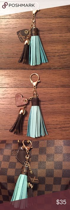 """Rehabbed Louis Vuitton bag charm/keychain RESERVED FOR dlmahaffey1!!  Made by me!  Using pre-loved, unusable authentic Louis Vuitton handbags, I've created a mini LV canvas tassel accented with a bit larger mint-colored leather tassel topped with LV canvas and a small LV canvas heart with dark brown leather backing.  All pieces hang from a swivel gold lobster clasp.  Entire length is 6"""". Louis Vuitton Accessories Key & Card Holders"""