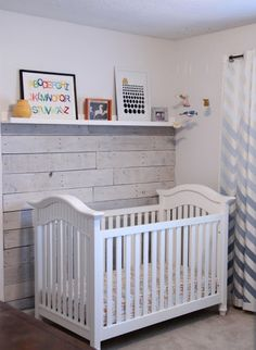 3/4 wood-plank wall as a back drop for crib.. Love the mantle idea for shelving! Cute!!