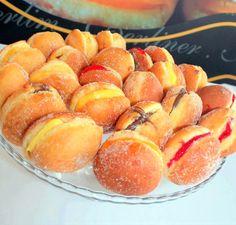 Bolas de berlim com creme de ovos, doce de morango, nutella
