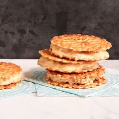 """Peanut Butter And Banana Swirl Waffle Ice Cream Sandwiches WW 4 Smart Points each!     1⁄4C powdered peanut butter - 2SP     2T water, cold     1C banana - 0SP     1C light churn style vanilla ice cream - 7SP     8 vanilla pizzelle (3-4"""") - 7SP Stir together powdered peanut butter and water in a small bowl to consistency of peanut butter. Lightly mash banana and pb into ice cream to combine. Spoon 1/2C ice cream mixture onto a cookie; sandwich with 2nd. Freeze until firm, about 1 hour."""