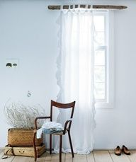 Real Simple   Easy, Beach-Inspired Decorating Ideas    Artfully Filter Light  A gauzy curtain diffuses daylight and makes a luminous backdrop for whatever you put in front of it—even a simple chair. The idea is to gracefully reveal (rather than conceal) the window, so a single panel is all you need. Pick a panel with generous length to create lush, romantic pooling on the floor.