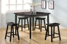 The Gaucho 5Pc Pack Counter Height Dining Set offers simplicity with a versatility perfect for any small dining space. This set boasts an space saving design	 square leg table and four matching saddle style stools. The Table features a Solid Wooden Top and square legs in Black finish. The Saddle Stools include wooden seat and square legs complemented by 4 footrests supports. (Assembly Required)