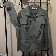 NWOTLightweight StudioWorks Woman Olive Jacket NWOT Lightweight Studio Works Woman Olive Green Jacket. Zips from Neck to Hem so collar can be worn up or down. 2 Buttoned Pockets, Snap Cuffed Sleeves & 8 Vent Holes (2 Under Arm in Front & 2 in Back). Fits true to size which is a bit snug on me.                                              Also Available In Blue & Khaki Studio Works Woman Jackets & Coats
