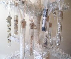 Perfume Bottles/Glass Viles ornaments??? | Empty bottles in a well ventilated area, clean well. Fill with little treasures: vintage photo, pearls, buttons, music, silver beads, glitter, rafia, etc. Spray lids a shabby creamy color. Screw the lids on with a dab of clear glue cement to hold in little vintage pieces of trim for the hangers. FOR VILES: FInd cork stoppers fit snuggly. Also pick up little teeny eye screws to screw into the cork center to hold your ribbon. --@ The Robin and Sparrow