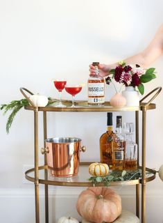 Want to get your bar cart Thanksgiving Day ready? Add pumpkins, greenery, and your favorite whiskies! #womenandwhiskies