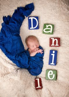 NEw born photo shoot idea. Spell the baby's name with blocks