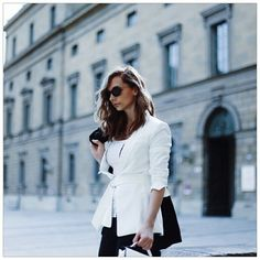 White blazer, shades and a black coat, love it!!