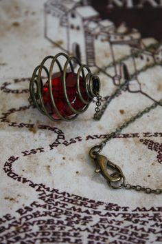 Harry Potter Necklace Remembrall--- this is so cool! Even if its not harry potter, but that just makes it all the cooler