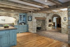 LOVE this kitchen!!!!! A bit too much stone even for me :o) but adore everything else about it!!!! Also like this shade of blue....stands out & is different than an overload of stained wood & stone ♥ ♥