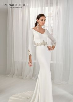 Estilo NLOZO TAI A ¾ length sleeved crepe dress with a glamorous beaded waist motif, cut out cuff detail and wide V back. Crepe Wedding Dress, Bridal Wedding Dresses, Crepe Dress, Wedding Dress Styles, Designer Wedding Dresses, Wedding Bells, Ronald Joyce Wedding Dresses, Dress Out, Cheap Dresses