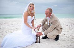 Love this beach idea. Take sand from the beach wedding to put into your own hour glass.  Aqua Florida Beach Wedding