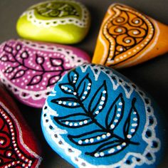 Painted stones - This would be a fun craft for girls night! With wine, of course....