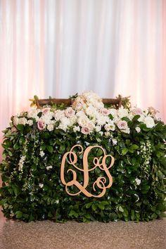 Photo: Justin DeMutiis; Elegant wedding reception bride & groom head table idea;