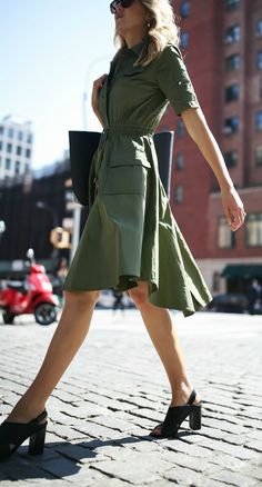 olive green utility shirtdress midi length fit and flare with cinched drawstring tie waist // black heel criss cross heeled sandals // black leather tote bag // casual friday workwear office style