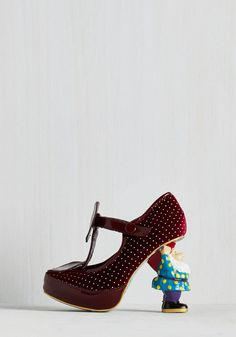 When in Gnome Heel in Burgundy. Go with the garden-party flow and surprise guests by introducing the fella who supports the burgundy velvet uppers of these heels - a design from the hard-to-find Gold Label of Irregular Choice! #red #modcloth
