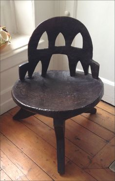 ::Solid wooden chair carved from one piece of wood . Ethiopia , early 20th century. via Esther Fitzgerald Rare Textiles