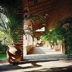 Todos Santos Inn, Baja, Mexico | Hidden away in a quiet village near Cabo San Lucas is this enchanted brick-and-adobe hacienda. Disappear into one of its antique canopy beds, or head to a nearby beach.