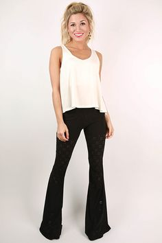 These black bell bottoms are definitely a closet necessity! We love the eyelet detail and elastic waist that makes them so cute and comfortable!
