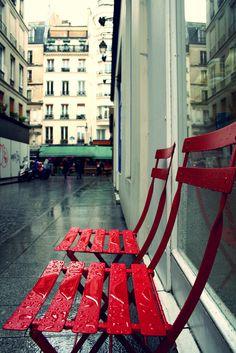 Wet red chairs, Montorgueil quarter, Paris by jibanger