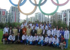 President Elbegdorj with the team in front of the Village Olympic rings.