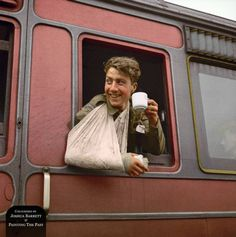 A wounded British soldier (possibly a Welsh Guardsman) enjoys a cup of tea on a hospital train in England following his evacuation from Normandy, June 7th 1944.  (Source - © IWM H 39254)  (Colourised by Joshua Barrett from the UK)
