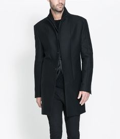 Faux Leather Overcoat in black by Zara (Portugal) €129. Outer Shell:  41% Cotton, 35% Wool, 24% Polyester. Lining:  Body Lining: : 51% Polyester, 49% Viscose. Sleeve Lining: 65% Viscose, 35% Polyester. Ref. 5682/608.