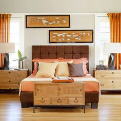 I am starting to think about how I am going to decorate my room next year, and as much as I LOVE pastels and whites and lightness, I tend to go for darker woods and warmer colors... my look is a little more eclectic, but I love the warm orange