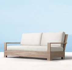 """RH's 74"""" Belvedere Classic Sofa:Modern minimalism combines with the beauty of substantial teak. A West Coast aesthetic informs the angular, low-slung profile, offering deeply comfortable seating. Our classic size collections are perfectly proportioned for smaller spaces."""