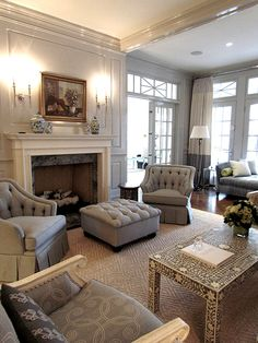 Beautiful room---love the transom, the drapes and furniture placement.
