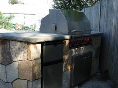 DIYNetwork.com experts demonstrate how to turn a plain backyard barbecue into a distinctive stone outdoor kitchen.