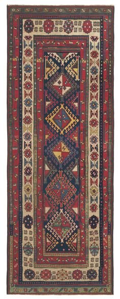 Caucasian Shulaver Kazak Runner, 3ft 9in x 9ft 10in, Circa 1875. Only very rarely do we have the opportunity to offer an outstanding collectible Caucasian carpet from the village of Shulaver, recognized for their series of latch hook medallions aligned down the center with partial medallions enclosing them on either side. This striking, elongated Caucasian Kazak rug is a premier, particularly old and well-preserved example of this style, offering a sonorous palette of aged hues.