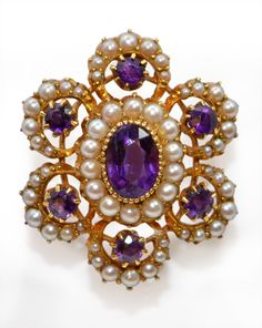 Victorian brooch, natural pearls and amethysts centrally set with 7 oval cut 1.10ct faceted amethysts framed with 55 fresh water 1-2mm split pearls in a handmade pierced 15 ct gold mounting