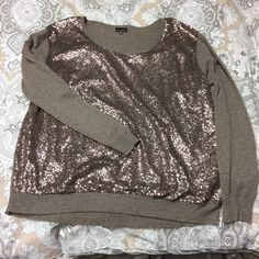 kiki la'rue mocha sequin sweater. a super adorable mocha sweater covered in sequins. only the best thing ever:] this has only been worn one time. i bought it from kiki la'rue. 67% acrylic, 29% nylon, 4% angora. zenobia. Sweaters Crew & Scoop Necks