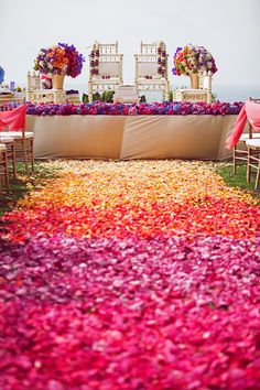 Vibrant Colorful Indian Wedding |We can't get enough of the heavenly ombre petal design that perfectly showcases this summer vibe and integration of pinks, purples and oranges.