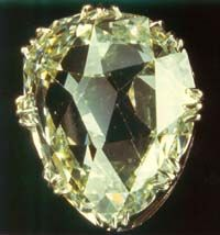 The Sancy Diamond has one of the most interesting, colorful, confused and involved histories of all the famous diamonds in Europe. It is a pale yellow 55.23-carat shield-shaped stone, apparently of Indian origin, and is said to be one of the first large diamonds to be cut with symmetrical facets. The stone is also unusual because it has no pavilion - just a pair of crowns, one on the other.