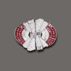 AN ART DECO RUBY AND DIAMOND DOUBLE-CLIP BROOCH   Each designed as a pavé-set diamond gathered ribbon motif, enhanced by tapered baguette and baguette-cut diamond trim, to the calibré-cut ruby detail, mounted in platinum, circa 1935