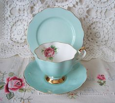 Queen Anne tea cup, saucer and plate in turquoise with Pink Rose