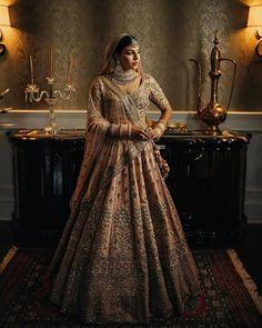 Designer dull pink embellished bridal lehenga stealing our hearts. Indian Bridal Lehenga, Indian Bridal Outfits, Pakistani Bridal Wear, Indian Bridal Fashion, Indian Designer Outfits, Bridal Dresses, Bridal Lenghas, Wedding Lehanga, Desi Bride